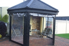 Gazebo with side panels with windows and zips that role up