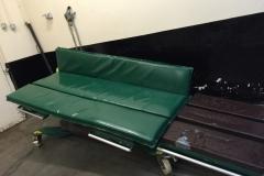 Padded mat for vet operating table